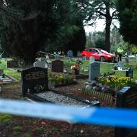 A police officer stands guard at the London road cemetery in Salisbury where the wife and son of Sergei Skripal are buried on Thursday. Sergei Skripal, 66, who moved to Britain in a 2010 spy swap, is unconscious in critical but stable condition in a hospital along with his daughter, Yulia, after they collapsed on a bench outside a shopping center on Sunday. | AFP-JIJI