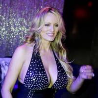 Adult-film actress Stephanie Clifford, also known as Stormy Daniels, poses for pictures at the end of her striptease show in Gossip Gentleman club in Long Island, New York, Feb. 23. | REUTERS