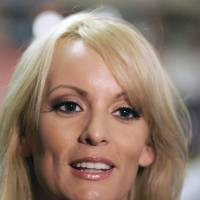 Stormy Daniels visits a restaurant in downtown New Orleans in 2009. The adult film actress who said she had sex with President Donald Trump is offering to return the $130,000 she was paid for agreeing not to discuss their alleged relationship. An attorney for Stormy Daniels, whose real name is Stephanie Clifford, sent a letter to Trump's lawyer Monday, saying she would wire the money to Trump if she could speak openly about their relationship. | AP