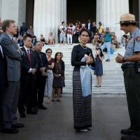 Myanmar's State Counselor Aung San Suu Kyi is guided by U.S. National Park Service Ranger Heath Mitchell as she visits the Lincoln Memorial in Washington on Sept. 14, 2016. | REUTERS