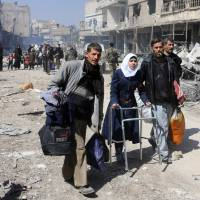 Thousands of Syrians flee assaults on Ghouta outside Damascus and Kurdish enclave of Afrin