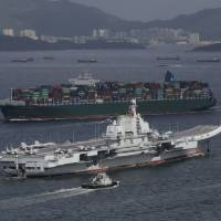 The Liaoning, China's first aircraft carrier, sails into Hong Kong for a port call last July. | AP