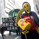 Protesters march during an anti-nuclear demonstration in Taipei on Sunday. Hundreds of Taiwanese took to the streets and demanded the government scrap using nuclear energy.