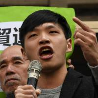 Sunflower movement student leader Chen Wei-ting speaks outside the Taiwan High Court in Taipei on Tuesday. | AFP-JIJI