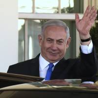 Israeli Prime Minister Benjamin Netanyahu waves as he leaves the White House in Washington Monday following his meeting with President Donald Trump. | AP