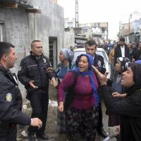Angry people try to stone the house of a man suspected of raping a 4-year-old girl, in Adana, southern Turkey, Feb. 11. The man narrowly escaped the neighborhood lynching attempt. The incident sparked a public outcry and calls for the government to increase the punishment of child sexual abuse offenders to include life sentences and chemical castration. | DHA-DEPO PHOTOS / VIA AP