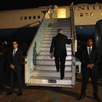 U.S. Secretary of State Rex Tillerson boards his plane to depart at the end of a five-country swing through Africa from Abuja, Nigeria, Monday. | AP