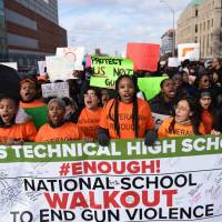 'Enough is enough' as U.S. students stage walkouts against guns, draw NRA ire