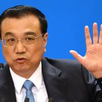 Chinese Premier Li Keqiang speaks during a news conference after the closing session of the National People's Congress in the Great Hall of the People in Beijing on Tuesday. | AFP-JIJI