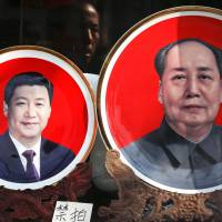 Souvenir plates showing Chinese President Xi Jinping and the late leader Mao Zedong are displayed at a shop near Tiananmen Square in Beijing in March 2016. | AP