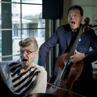 Marjorie Keith plays an impromptu duet of 'God Bless America' with cellist Yo-Yo Ma at the Valencia Terrace in Corona, California, March 2. Yo-Yo Ma also performed a special concert in Corona for the California children who authorities said were starved and shackled to their beds by their parents. | CINDY YAMANAKA / THE PRESS ENTERPRISE / VIA AP