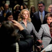 Summer Zervos, a former contestant on 'The Apprentice,' leaves New York State Supreme Court with attorney Gloria Allred after a hearing on the defamation case against U.S. President Donald Trump in Manhattan, New York City, Dec. 5. | REUTERS