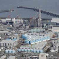Hundreds of tanks can be seen holding filtered coolant water from the damaged Fukushima No. 1 nuclear power plant. Seven years after the meltdown crisis started, Tokyo Electric Power Company Holdings Inc. is struggling with an ever-increasing volume of radioactive water at the site. | KYODO