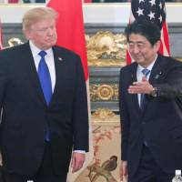 Prime Minister Shinzo Abe welcomes U.S. President Donald Trump to Tokyo in November. Abe said Friday that he and Trump agreed to meet in the United States next month. | POOL / VIA KYODO