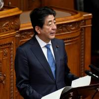 Prime Minister Shinzo Abe answers questions in the Upper House on Friday. | AFP-JIJI