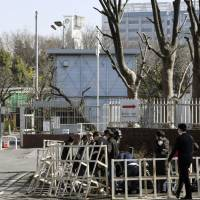 Reporters gather in front of a detention center in Tokyo on Wednesday following reports that the Justice Ministry has started transferring seven former members of the Aum Shinrikyo cult, who are now on death row, from the facility to detention centers in other areas. | KYODO