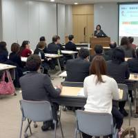 Company representatives attend a seminar on the rules for converting fixed-term contract workers into indefinite-term employees held in Shinjuku Ward, Tokyo, in March last year. | KYODO