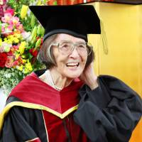 Kiyoko Ozeki, 88, who became the oldest person to earn a doctoral degree in Japan on Saturday, attends a ceremony at Ritsumeikan University in Kyoto. | KYODO