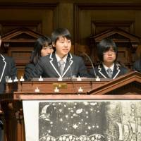 Satsuki Sekine (center), a student at Futaba Future High School, delivers a speech at a memorial service marking the 3/11 disasters in Japan at a church in New York on Sunday. | KYODO