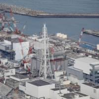 An aerial view of the crippled Fukushima No. 1 nuclear power plant is seen on Feb. 21. | KYODO
