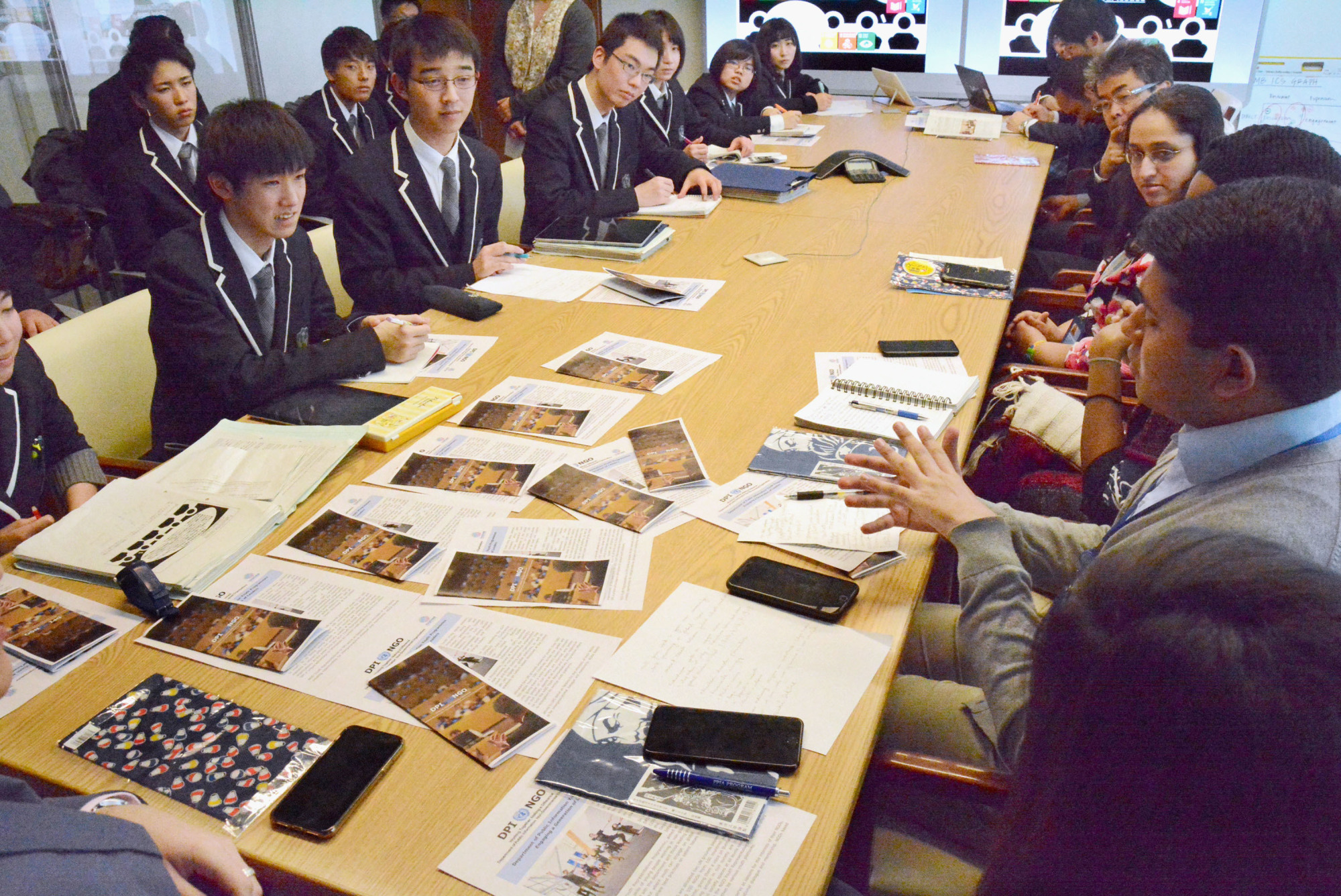 Students from Fukushima's Futaba Future High School meet diplomats, staff and youth representatives at the United Nations in New York on March 9. | KYODO