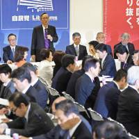 Lawmakers of the ruling Liberal Democratic Party gather at a meeting last month on revising the constitution, at LDP headquarters in Tokyo. | KYODO