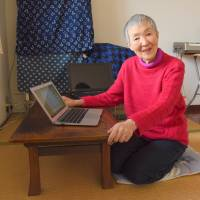 Masako Wakamiya is seen with her two laptop computers in her living room in Fujisawa, Kanagawa Prefecture. | SATOKO KAWASAKI