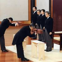 The previous Kenji to Shokei no gi — a ceremony for handing down the Sacred Sword and Curved Jewels of the Imperial regalia to the new emperor, as well as the Privy Seal and the State Seal — was held at the Imperial Palace (above) on Jan. 7, 1989. | POOL / VIA KYODO