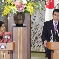 Foreign Minister Taro Kono (right) and Indian External Affairs Minister Sushma Swaraj attend a mews conference in Tokyo after holding a bilateral meeting on Thursday. | KYODO