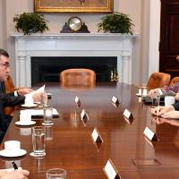 Foreign Minister Taro Kono meets with U.S. Vice President Mike Pence on Friday at the White House. | FOREIGN MINISTRY / VIA KYODO