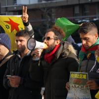 Eyyup Kurt speaks via a megaphone at a rally with other Kurds in front of United Nations University in Tokyo on Jan. 23, calling on the U.N. to address Turkey's recent attacks on Kurds in the northern Syrian town of Afrin. | CHISATO TANAKA