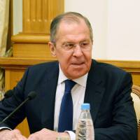Russian Foreign Minister Sergey Lavrov speaks during a group interview in Moscow on Thursday. | KYODO