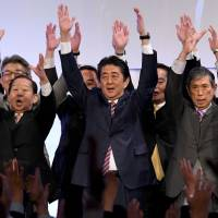 Prime Minister Shinzo Abe leads a banzai cheer at the end of the Liberal Democratic Party's convention in Tokyo on Sunday. | AFP-JIJI