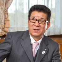 Osaka Gov. Ichiro Matsui speaks with The Japan Times in an exclusive interview at his office on Feb. 22. | KATSUO SUGANO