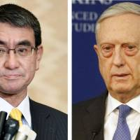 Taro Kono (left) proposed preconditions for the upcoming U.S.-North Korea summit, including a promise by Pyongyang to resolve the abduction issue, to U.S. Defense Secretary Jim Mattis and other top officials earlier this month. | AP / KYODO