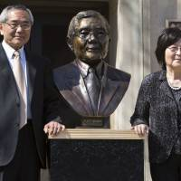 Nobel laureate and Purdue University professor Eiichi Negishi with his wife, Sumire, pose after the 2014 unveiling of a bronze sculpture of him outside of Wetherill Laboratory of Chemistry on campus at Purdue University in West Lafayette, Indiana. Sumire Negishi was found dead Tuesday in a northern Illinois landfill after her Nobel Prize-winning husband was found wandering a road south of Rockford, Illinois, police said. | MICHALE HEINZ / JOURNAL