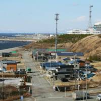 The Oma nuclear plant (right) is shown under construction Monday in the town of Oma, Aomori Prefecture. | KYODO