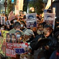 Protesters stage a rally Tuesday against the administration of Prime Minister Shinzo Abe near his official residence in Tokyo. | SATOKO KAWASAKI