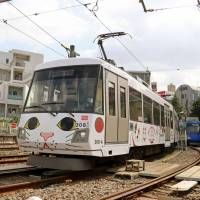 Tokyu Corp.'s Setagaya Line streetcars decorated with maneki-neko cats run through Setagaya Ward, Tokyo, in a photo taken in September. | VIA KYODO