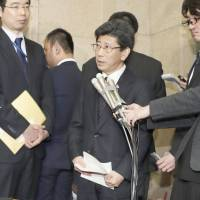 Former National Tax Agency chief Nobuhisa Sagawa faces reporters Friday at the Finance Ministry after resigning in the midst of the growing controversy over the ministry's heavily discounted sale of land to Osaka-based school operator Moritomo Gakuen. | KYODO