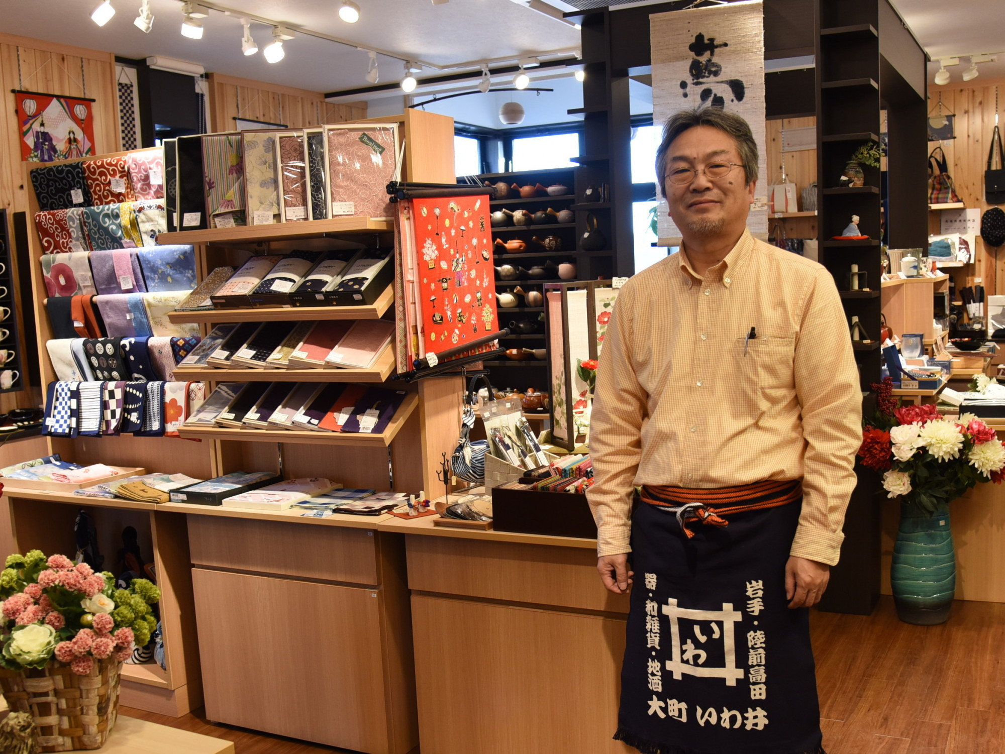 Seitoku Iwai, a 12th-generation shop owner in Rikuzentakata, Iwate Prefecture, says there's a certain joy in re-creating a community from scratch. | SATOKO KAWASAKI