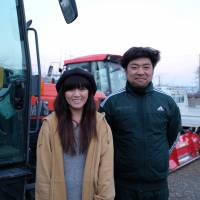 Rice farmers Emi Kato and her husband, Koji, say they are seeing in changes in people's attitudes toward Fukushima produce. | MIZUHO AOKI