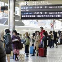 People wait at Hamamatsu Station after a power failure halted trains on the Tokaido Shinkansen Line between Shizuoka and Hamamatsu stations on Sunday. | KYODO