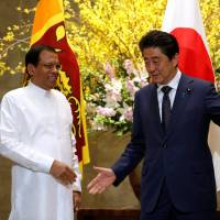Prime Minister Shinzo Abe meets Sri Lanka's President Maithripala Sirisena at his office in Tokyo on Wednesday. | REUTERS