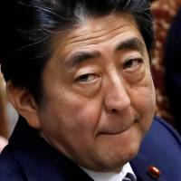 Prime Minister Shinzo Abe attends at an Upper House parliamentary session in Tokyo on Wednesday. | REUTERS