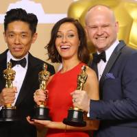 Kazuhiro Tsuji, Lucy Sibbick (center) and David Malinowski show off their Oscar for best makeup and hairstyling for the film 'Darkest Hour' during the 90th annual Academy Awards in Hollywood, California, on Sunday. | REUTERS