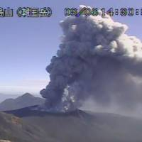 Footage taken by a weather agency camera Tuesday afternoon shows plumes of smoke billowing from Shinmoedake, a volcano  straddling Kagoshima and Miyazaki prefectures. | KYODO
