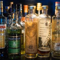 A row of spirits sits on the bar at Bar Trench in Tokyo's Ebisu district. | DAN SZPARA