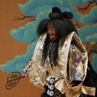 Subtle moves: Hisa Uzawa performs as the shite in the play 'Tamura.' This month she will face a formidable challenge when she performs in a play titled 'Takasago,' which will be shown at the National Noh Theatre. | SHIGERU HAFUKA