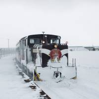 Thawing out on the stove train through Tsugaru